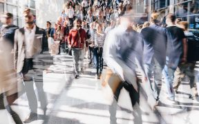 a blurred image to give the impression of movement of a crowd walking in public